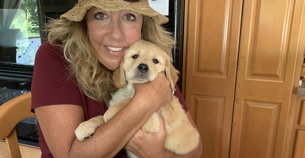 Cajam Marketing President Kathy Gould volunteers as a seeing eye puppy raiser